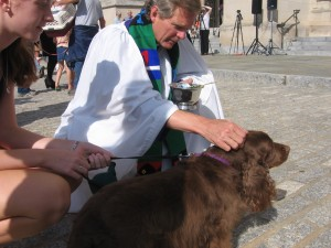 Lilly is blessed by Dean Sam Lloyd at the National Cathedral, St. Francis Day