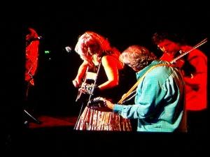 Emmylou, Ronnie Simpkins, and Sam Bush on the Watson Stage