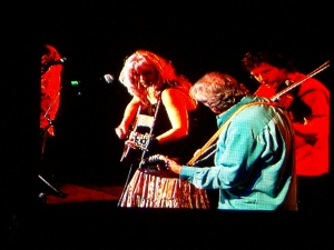 Emmylou, Ronnie Simpkins, and Sam Bush on the Watson Stage