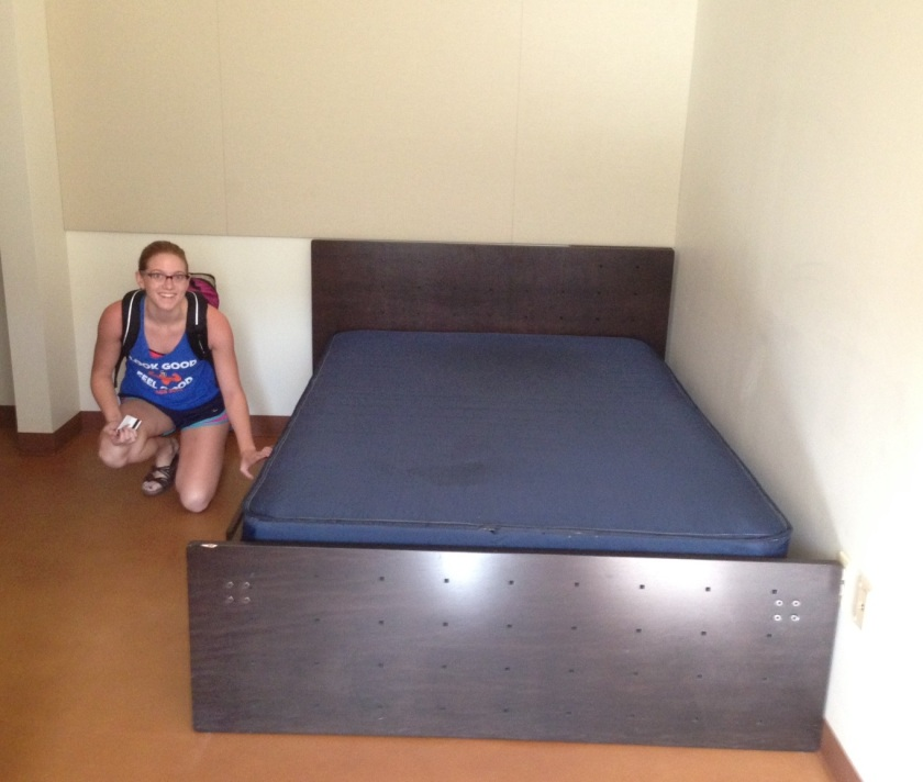 Claire checks out her new bed in her dorm room