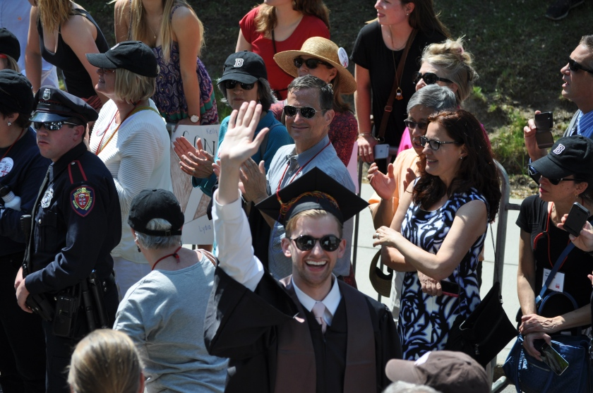 Andrew waves from the procession