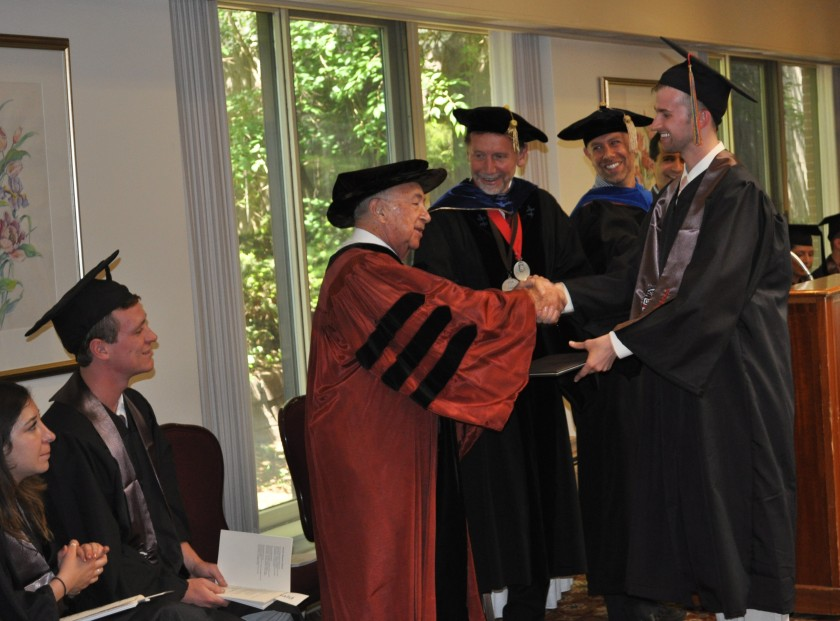 Receiving his diploma