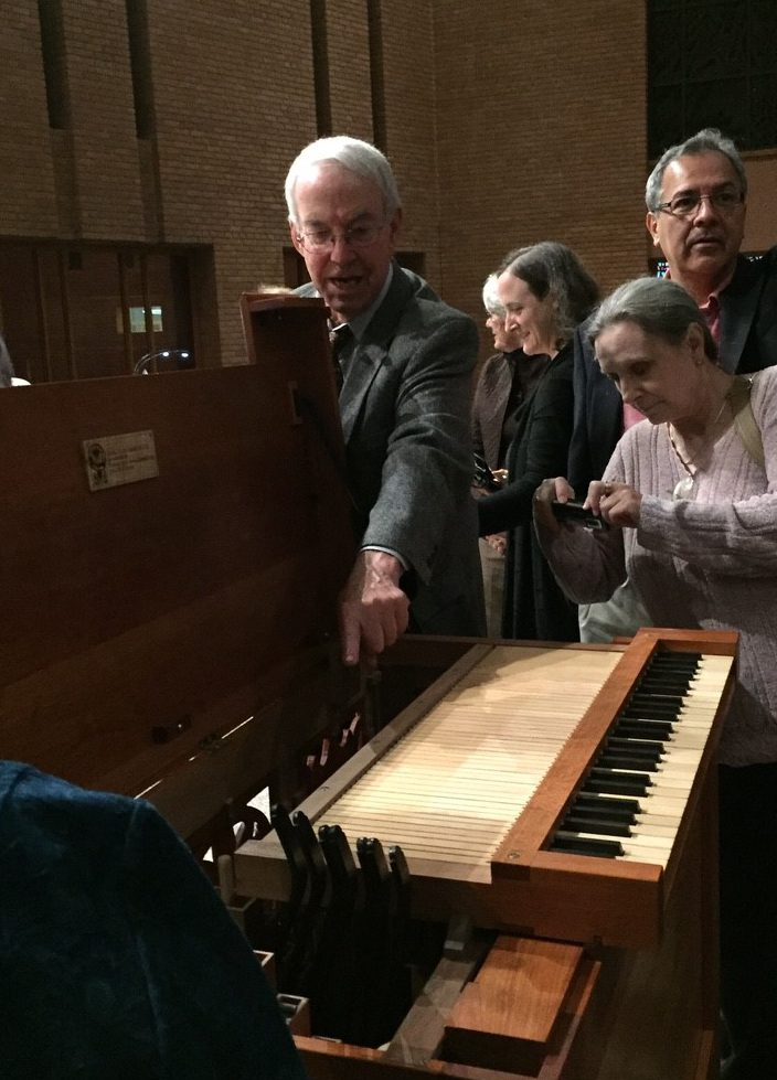 John Boody points to features on Opus 72 following the inaugural concert at Bradley Hills Presbyterian Church